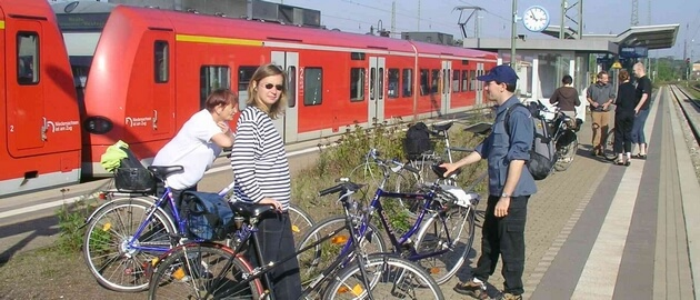 Cyclist at a train station